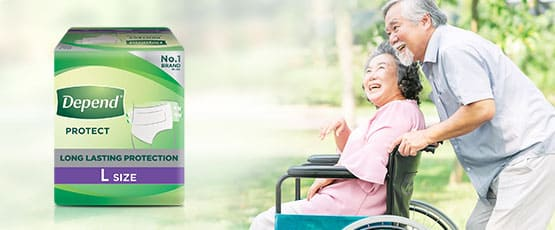 elderly man pushing elderly woman in a wheelchair with Depend protection Tape product pack, and a 'learn more' button